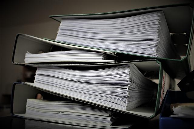 přemíra papírování, byrokracie